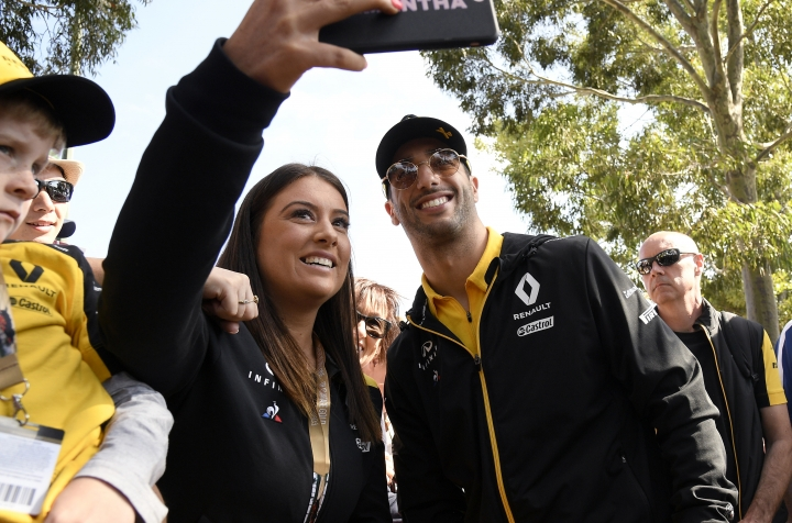 Renault driver Daniel Ricciardo of Australia, right, poses for a photo with a fan ahead of the Australian Grand Prix in Melbourne, Australia, Thursday, March 14, 2019. (AP Photo/Andy Brownbill)