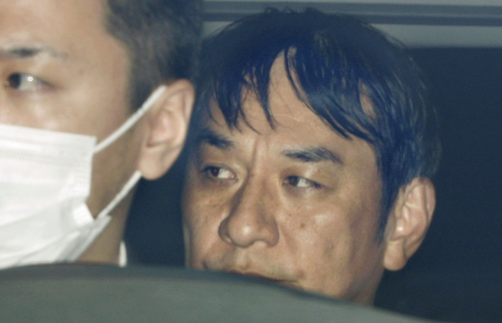 """In this March 14, 2019, photo, Japanese musician Pierre Taki in a police car is sent to a prosecutor's office in Tokyo. Japanese entertainment company Sega has cancelled shipments of its video game """"Judgment,"""" also known as """"Judge Eyes,"""" after Taki was arrested on drug charges. (Takuya Inaba/Kyodo News via AP)"""