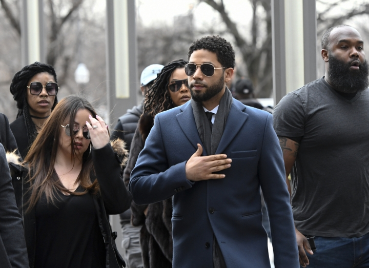 Empire actor Jussie Smollett, center, arrives at the Leighton Criminal Court Building for his hearing on Thursday, March 14, 2019, in Chicago. Smollett is accused of lying to police about being the victim of a racist and homophobic attack by two men on Jan. 29 in downtown Chicago. (AP Photo/Matt Marton)