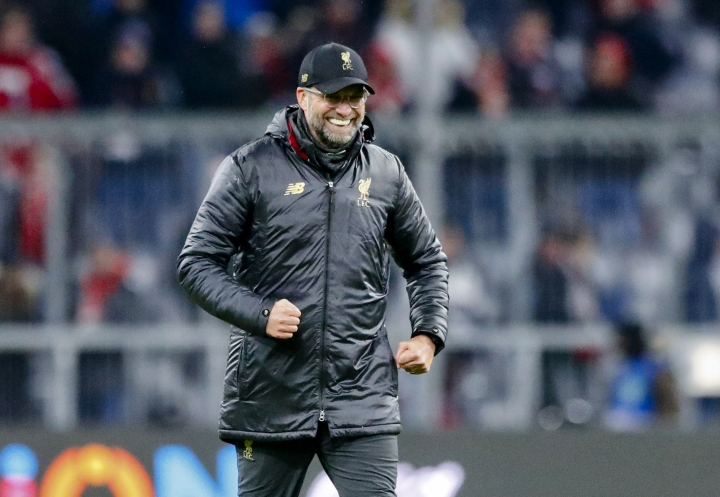 Liverpool coach Juergen Klopp celebrates at the end of the Champions League round of 16 second leg soccer match between Bayern Munich and Liverpool in Munich, Germany, Wednesday, March 13, 2019. (AP Photo/Matthias Schrader)