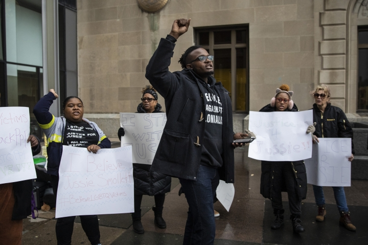 Supporters of Jussie Smollett rally outside the Leighton Criminal Courthouse, where the actor was scheduled to appear for a hearing, Thursday, March 14, 2019. Smollett is accused of lying to police about being the victim of a racist and homophobic attack by two men on Jan. 29 in downtown Chicago. (Ashlee Rezin/Chicago Sun-Times via AP)