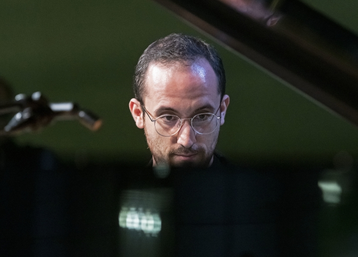 FILE - In this Nov. 9, 2018 file photo, Russian-German pianist Igor levit plays at the Green party convention in Leipzig, Germany. The 32-year-old pianist, winner of last year's Gilmore Artist Award, is among the most probing young artists in classical music. (AP Photo/Jens Meyer, File)