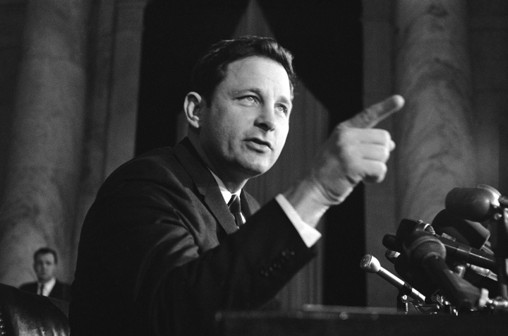 FILE - In this Nov. 8, 1968 file photo, Sen. Birch Bayh, D-Ind., chairman of the Senate constitutional amendments subcommittee, speaks at a news conference in Washington. Bayh, who championed the federal law banning discrimination against women in college admissions and sports, died from pneumonia at his home in Easton, Md., Thursday, March 14, 2019, at age 91, his family said said in a statement. (AP Photo/Henry Griffin, File)