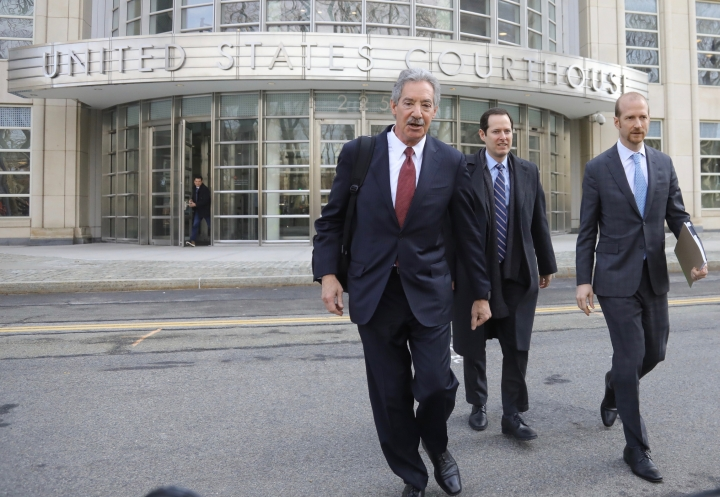 Lawyers for the Chinese electronics giant Huawei from left, James Cole, Michael Alexander Levy, and David Bitkower leave Brooklyn federal court in New York, Thursday March 14, 2019. Lawyers for Huawei have entered a not-guilty plea in a U.S. case charging the company with violating Iran trade sanctions. (AP Photo/Bebeto Matthews)