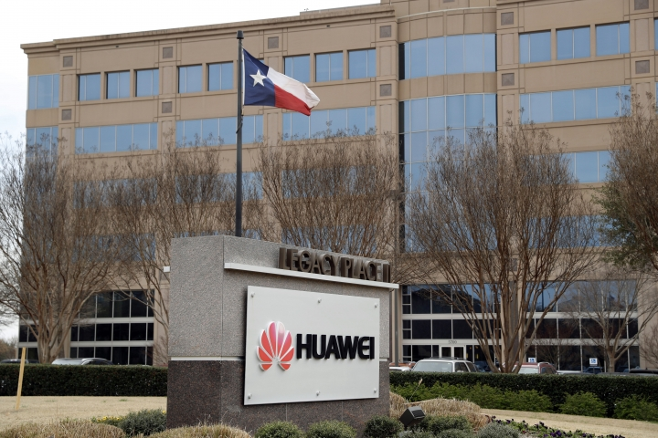 FILE - This March 7, 2019 file photo shows the Huawei Technologies Ltd. business location in Plano, Texas. The No. 2 smartphone maker in the world will be arraigned at federal court in New York on Thursday, March 14. Prosecutors have accused Huawei of using a Hong Kong front company to trade with Iran in violation of U.S. sanctions. (AP Photo/Tony Gutierrez, File)