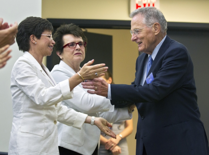 """FILE - In this June 20, 2012 file photo, former Sen. Birch Bayh, D-Ind., the author of Title IX in Congress, is applauded by Senior Adviser to the President and Chair of the Council on Women and Girls Valerie Jarrett, left, and tennis great Billie Jean King, center during a forum in the South Court Auditorium at the White House in Washington in a gathering to celebrate the 40th anniversary of Title IX. Bayh, who championed the federal law banning discrimination against women in college admissions and sports, died from pneumonia at his home in Easton, Md., Thursday, March 14, 2019, at age 91. King, who worked with Bayh on women's rights issues, released a statement with his family Thursday saying the former senator was """"one of the most important Americans of the 20th century."""" (AP Photo/Manuel Balce Ceneta, File)"""