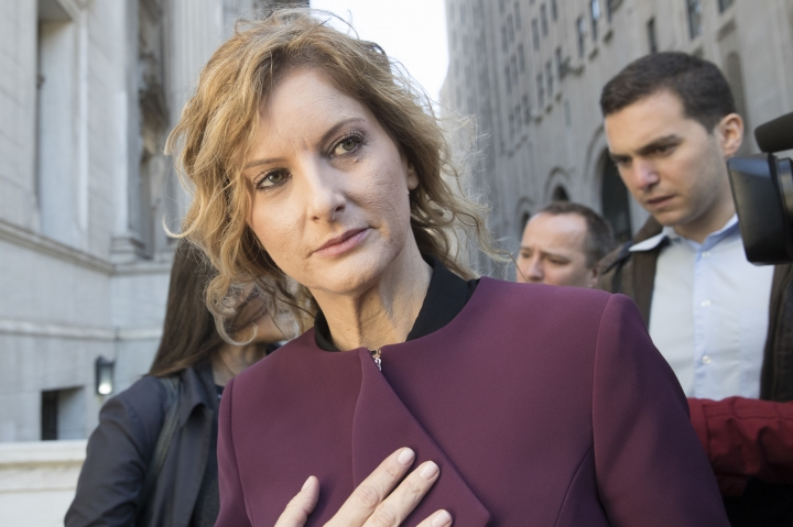 "In this Oct. 18, 2018 file photo, Summer Zervos leaves New York state appellate court in New York. A New York appeals court has ruled that President Donald Trump isn't immune from a defamation lawsuit filed by the former ""Apprentice"" contestant who accused him of unwanted kissing and groping. (AP Photo/Mary Altaffer, FILE)"