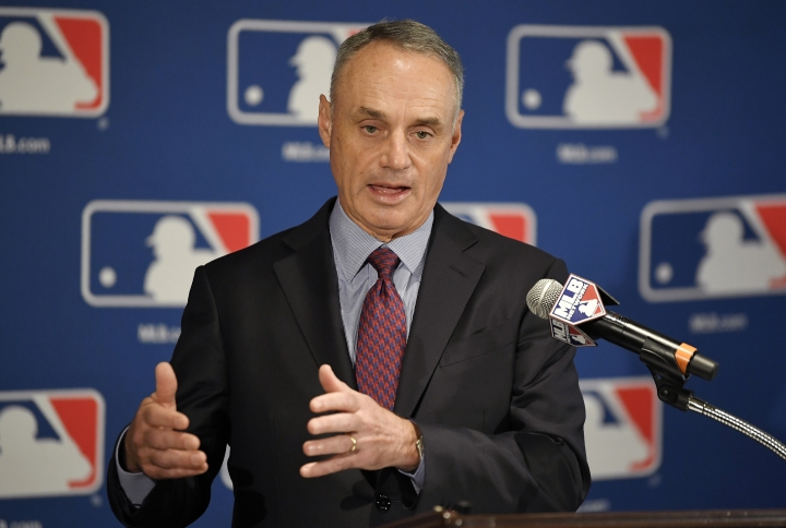 FILE - In this Feb. 1, 2018, file photo, Major League Baseball commissioner Rob Manfred speaks during a news conference in Los Angeles. Major League Baseball and its players' union reached an unprecedented agreement to discuss renegotiating their labor contract that has three seasons remaining, part of a deal that includes modest rule changes for 2020 and drops pitch clocks until 2022 at the earliest. (AP Photo/Mark J. Terrill, File)