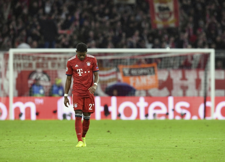 Bayern defender David Alaba reacts during the Champions League round of 16 second leg soccer match between Bayern Munich and Liverpool at the Allianz Arena, in Munich, Germany, Wednesday, March 13, 2019. (AP Photo/Kerstin Joensson)
