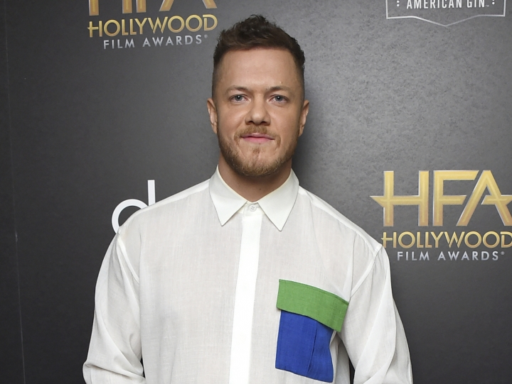"FILE - In this Nov. 4, 2018 file photo, Dan Reynolds, of Imagine Dragons, winner of the award for Hollywood documentary for ""Believer,"" poses in the press room at the Hollywood Film Awards in Beverly Hills, Calif. Reynolds posted a lengthy note on Instagram two weeks ago, calling out bands like Slipknot, the 1975 and Foster the People for taking shots at Imagine Dragons. Reynolds says, ""It's just, to me, counterproductive to all of us as artists to engage in menial, self-indulgent conversation."" (Photo by Jordan Strauss/Invision/AP, File)"