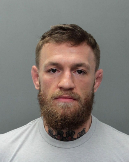 This photo provided by the Miami-Dade Corrections and Rehabilitation Department shows Conor McGregor. Authorities say mixed martial artist and boxer Conor McGregor has been arrested in South Florida for stealing the cellphone of someone who was trying to take his photo. A Miami Beach police report says the 30-year-old McGregor was arrested Monday, March 11, 2019 and charged with robbery and criminal mischief. (Miami-Dade Corrections and Rehabilitation Department via AP)