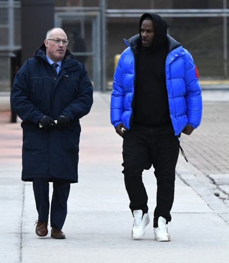 FILE - In this Monday, Feb. 25, 2019 file photo, R. Kelly, right, leaves Cook County Jail with his defense attorney, Steve Greenberg, in Chicago. Sex videos like those that have been integral to the criminal cases against R. Kelly have been circulating across the nation for years. Some of the tapes leaked out of the singer's collection in the 1990s. (AP Photo/Matt Marton, File)