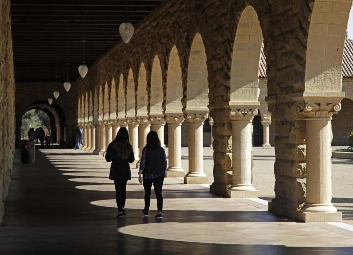 Students walk on the Stanford University campus Thursday, March 14, 2019, in Santa Clara, Calif. In the first lawsuit to come out of the college bribery scandal, several students are suing Yale, Georgetown, Stanford and other schools involved in the case, saying they and others were denied a fair shot at admission. The plaintiffs brought the class-action complaint Wednesday, March 13, 2019, in federal court in San Francisco on behalf of themselves and other applicants and asked for unspecified damages. (AP Photo/Ben Margot)