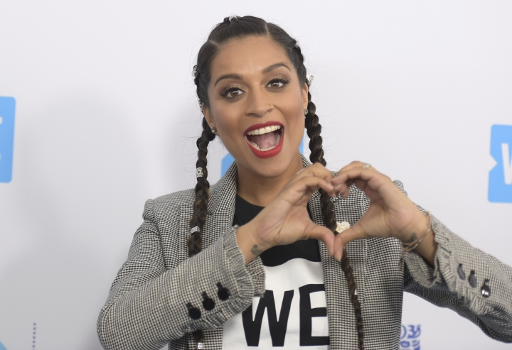"FILE - In this April 19, 2018 file photo, Lilly Singh arrives at WE Day California at The Forum in Inglewood, Calif. NBC is shaking up late-night TV, giving Carson Daly's slot to a woman of color who's a star on YouTube. The network said Thursday, March 14, 2019, that a new show, titled ""A Little Late with Lilly Singh,"" will air at 1:35 a.m. EDT beginning in September. (Photo by Richard Shotwell/Invision/AP, File)"