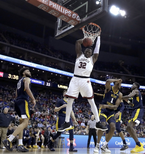 Texas Tech's Norense Odiase (32) dunks during the first half of the team's NCAA college basketball game against West Virginia in the Big 12 men's tournament Thursday, March 14, 2019, in Kansas City, Mo. (AP Photo/Charlie Riedel)