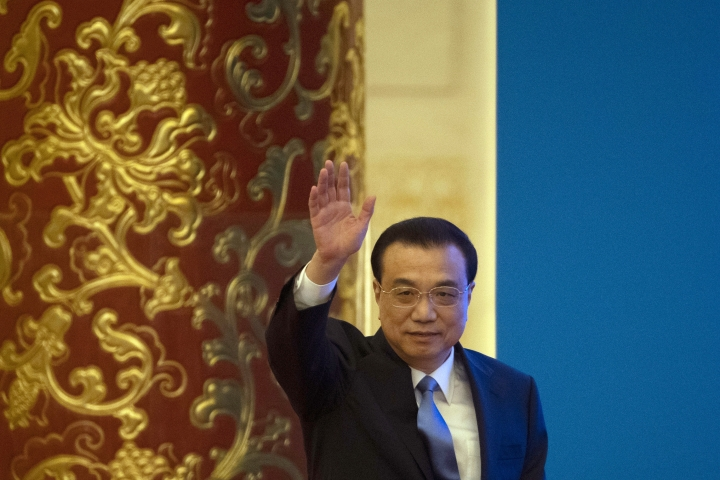 Chinese Premier Li Keqiang arrives for a press conference after the closing session of the National People's Congress in Beijing's Great Hall of the People on Friday, March 15, 2019. (AP Photo/Ng Han Guan)