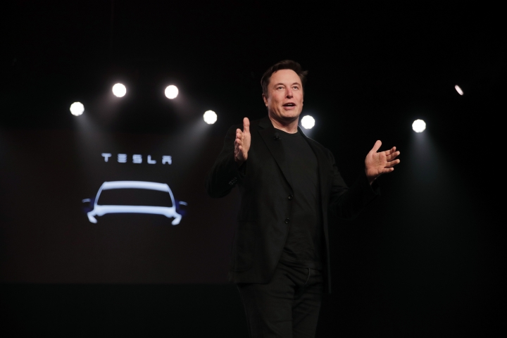 Tesla CEO Elon Musk speaks before unveiling the Model Y at Tesla's design studio Thursday, March 14, 2019, in Hawthorne, Calif. The Model Y may be Tesla's most important product yet as it attempts to expand into the mainstream and generate enough cash to repay massive debts that threaten to topple the Palo Alto, Calif., company. (AP Photo/Jae C. Hong)