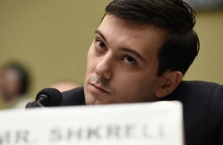 FILE - In this Thursday, Feb. 4, 2016 file photo, former Turing Pharmaceuticals CEO Martin Shkreli attends the House Committee on Oversight and Reform Committee hearing on Capitol Hill in Washington. Shkreli, who provoked outrage with a 5,000 percent hike in the price of a vital drug, is serving a seven-year sentence in federal prison for securities fraud. (AP Photo/Susan Walsh)