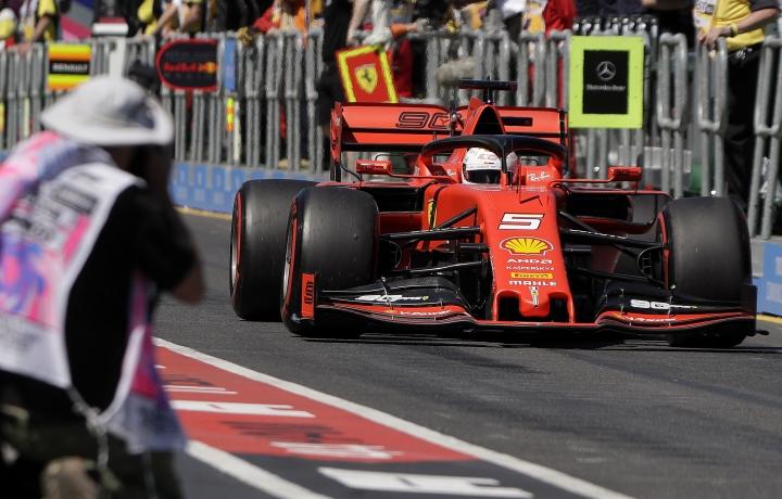 Ferrari driver Sebastian Vettel of Germany drives down pit lane during the first practice session of the Australian Grand Prix in Melbourne, Australia, Friday, March 15, 2019. The first race of the year is Sunday. (AP Photo/Rick Rycroft)