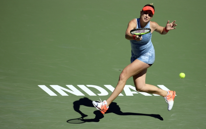 Belinda Bencic, of Switzerland, returns a shot to Karolina Pliskova, of the Czech Republic, at the BNP Paribas Open tennis tournament Thursday, March 14, 2019, in Indian Wells, Calif. (AP Photo/Mark J. Terrill)