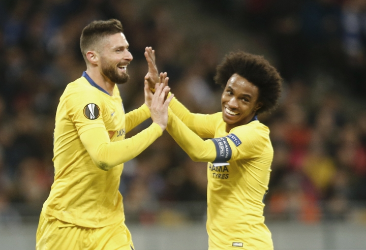 Chelsea's Olivier Giroud celebrates with his teammates Chelsea's Willian after scoring his side's second goal during the Europa League round of 16, second leg soccer match between Dynamo Kiev and Chelsea at the Olympiyskiy stadium in Kiev, Ukraine, Thursday, March 14, 2019. (AP Photo/Efrem Lukatsky)