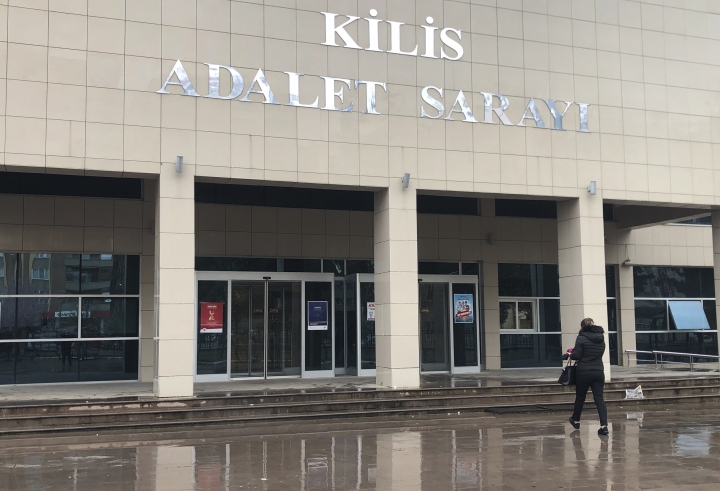 A woman walks to the court in Kilis, southeastern Turkey, Friday, March 15, 2019. The court convicted Neil Prakash, a former rapper from Melbourne of belonging to a terror group and sentenced him to more than seven years in prison. Prakash has been in a Turkish prison since 2016 when he was arrested near the Syrian border for attempting to cross into Turkey with fake documents. He had featured in IS videos, been linked to several attack plans in Australia and has urged lone wolf attacks against the United States. (AP Photo/Mehmet Guzel)