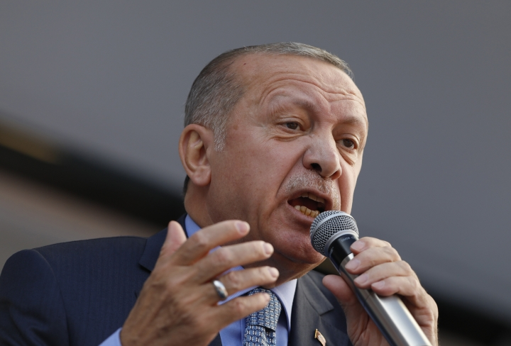 """Turkey's President Recep Tayyip Erdogan addresses the supporters of his ruling Justice and Development Party, AKP, during a rally in Ankara, Turkey, Thursday, March 14, 2019. Continuing an exchange of words with the Israeli prime minister, Erdogan says Benjamin Netanyahu is """"walking around with this stain"""" of corruption, in an interview with Haberturk television late on Thursday. (AP Photo/Burhan Ozbilici)"""