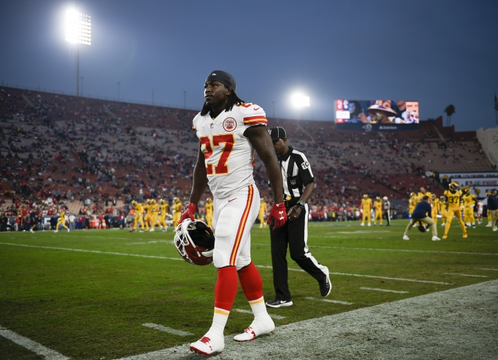 "FILE - In this Nov. 19, 2018, file photo, Kansas City Chiefs running back Kareem Hunt walks off the field prior to an NFL football game against the Los Angeles Rams, in Los Angeles. The NFL has suspended Browns running back Kareem Hunt for eight games after a video showed him kicking a woman and he was later involved in a fight at a resort. The league on Friday, March 15, 2019, cited a violation of its personal conduct policy ""for physical altercations at his residence in Cleveland last February and at a resort in Ohio last June."" Hunt will not be paid during the half-season suspension, which he will not appeal. (AP Photo/Kelvin Kuo, File)"