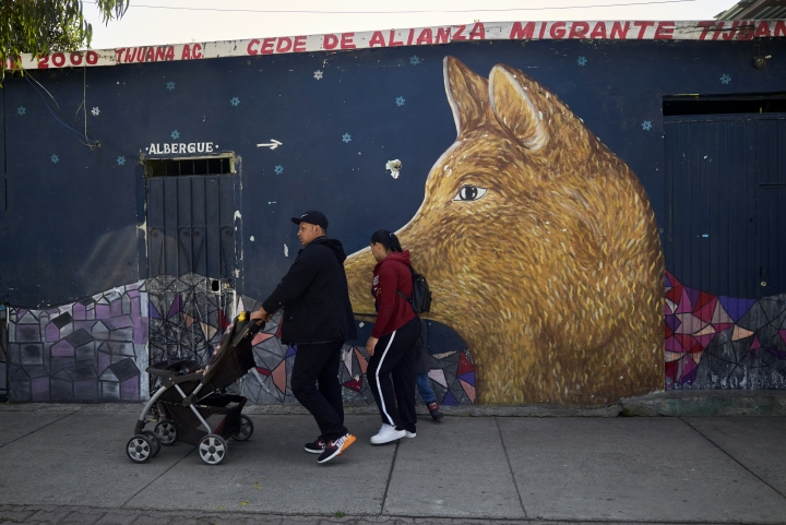In this March 5, 2019, image, Juan Carlos Perla and Ruth Aracely Monroy leave a shelter for migrants in Tijuana, Mexico with their sons. After fleeing El Salvador and requesting asylum in the United States, the family was returned to Tijuana to wait for their hearing in San Diego. They were one of the first families to contend with a new policy that makes asylum seekers stay in Mexico while their cases wind through U.S. immigration courts. (AP Photo/Gregory Bull)
