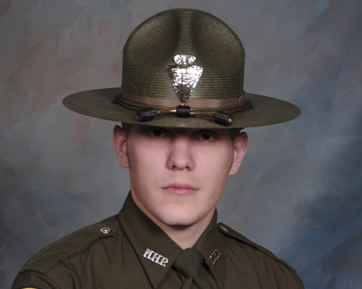 This undated booking photo provided by the Montana Highway Patrol shows Montana Highway Patrol Trooper Wade Palmer. Authorities say Palmer is in critical condition after being shot while investigating an earlier shooting in Missoula. Highway Patrol officials said in a statement Friday, March 15, 2019, another trooper found the wounded 35-year-old Palmer in his patrol car outside a bar in Evaro, Mont. early Friday. (Montana Highway Patrol via AP)