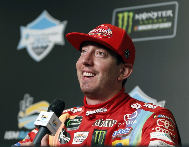 Kyle Busch smiles as he answers questions after winning the NASCAR Cup Series auto race at ISM Raceway, Sunday, March 10, 2019, in Avondale, Ariz. (AP Photo/Ralph Freso)