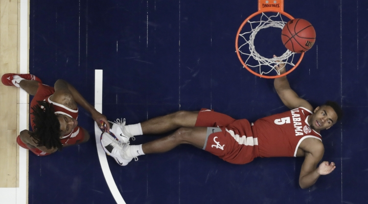 Alabama guard Avery Johnson Jr. (5) falls to the floor in the first half of an NCAA college basketball game against Kentucky at the Southeastern Conference tournament Friday, March 15, 2019, in Nashville, Tenn. (AP Photo/Mark Humphrey)