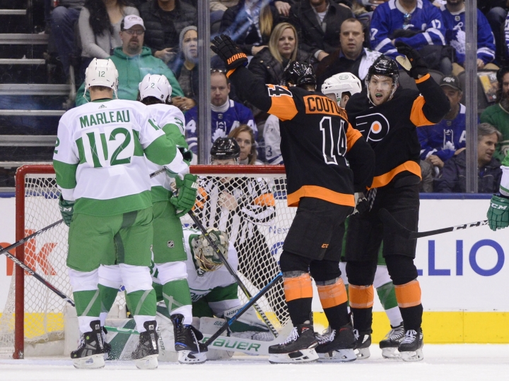 Philadelphia Flyers center Sean Couturier (14) reacts after teammate James van Riemsdyk (25) scored on Toronto Maple Leafs goaltender Frederik Andersen (31) during the second period of an NHL hockey game Friday, March 15, 2019, in Toronto. (Frank Gunn/The Canadian Press via AP)
