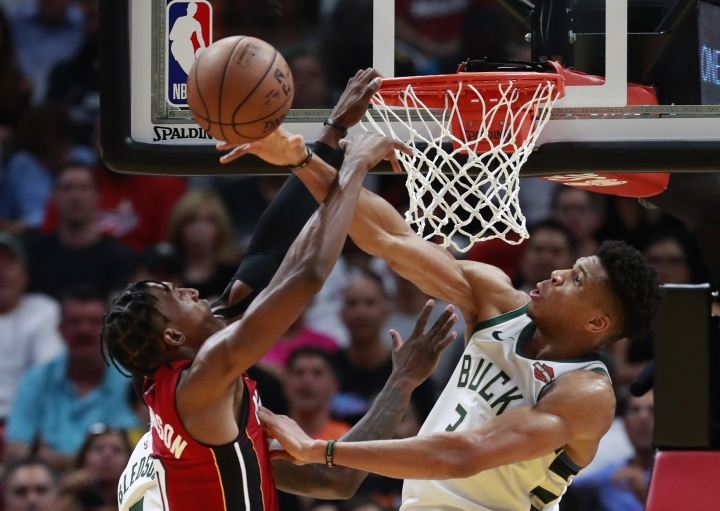 Milwaukee Bucks forward Giannis Antetokounmpo, right, blocks a shot by Miami Heat guard Josh Richardson during the second half of an NBA basketball game Friday, March 15, 2019, in Miami. The Bucks defeated the Heat 113-98. (AP Photo/Wilfredo Lee)