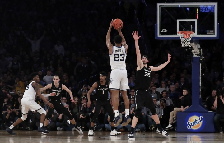 Villanova forward Jermaine Samuels (23) shoots against Xavier forward Zach Hankins (35) during overtime of an NCAA college basketball semifinal game in the Big East men's tournament, Friday, March 15, 2019, in New York. Villanova won 71-67 in overtime. (AP Photo/Julio Cortez)