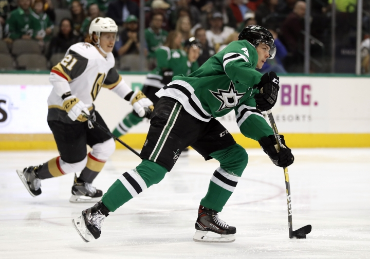 Dallas Stars defenseman Miro Heiskanen (4) handles the puck as Vegas Golden Knights' Cody Eakin (21) gives chase in the second period of an NHL hockey game in Dallas, Friday, March 15, 2019. (AP Photo/Tony Gutierrez)