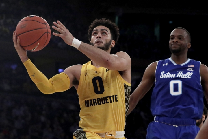 Marquette guard Markus Howard (0) goes up for a shot against Seton Hall guard Quincy McKnight (0) during the first half of an NCAA college basketball semifinal game in the Big East men's tournament, Friday, March 15, 2019, in New York. (AP Photo/Julio Cortez)