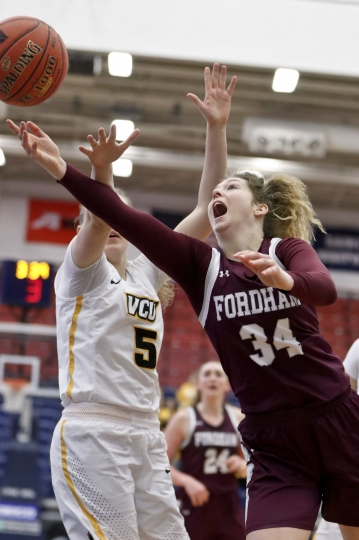 Fordham's Mary Goulding (34) shoots as VCU's Olga Petrova (5) defends during the second half of an NCAA college basketball game in the Atlantic 10 women's tournament championship game, Sunday, March 10, 2019, in Pittsburgh. (AP Photo/Keith Srakocic)
