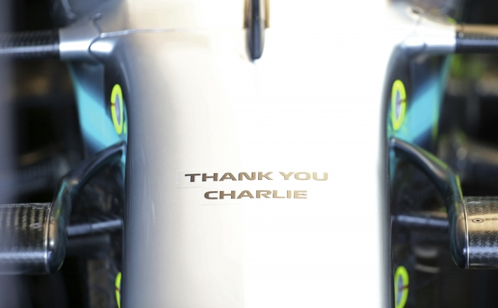 A tribute to Charlie Whiting, the former FIA Formula One Race Director who recently passed away, is on the front of Mercedes driver Lewis Hamilton's car during the final practice session for the Australian Grand Prix in Melbourne, Australia, Saturday, March 16, 2019. The first race of the year is Sunday. (AP Photo/Rick Rycroft)