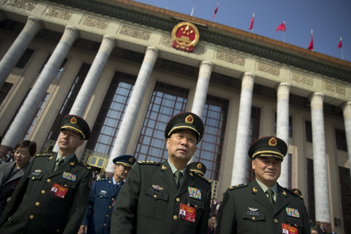 """In this March 4, 2019, photo, military delegates leave after a meeting one day before the opening session of China's National People's Congress (NPC) at the Great Hall of the People in Beijing. To a remarkable degree, the Pentagon's new budget proposal is shaped by national security threats that Acting Defense Secretary Patrick Shanahan has summarized in three words: """"China, China, China."""" (AP Photo/Mark Schiefelbein)"""