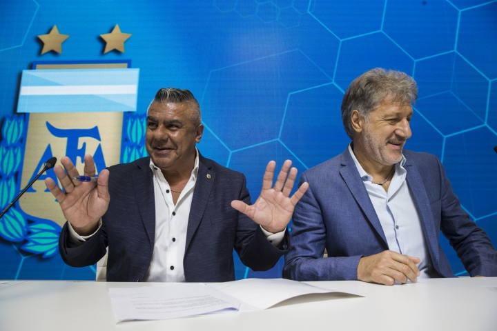 Claudio Tapia, president of Argentina's Soccer Federation, left, and General Secretary of the Argentina's Footballers' Union (FAA) Sergio Marchi, take part in a press conference to announce the early implementation of a plan to professionalize women's soccer in Buenos Aires, Argentina, Saturday, March 16, 2019. Almost 90 years after men's soccer turned professional in Argentina, the women's game is still being played by amateur athletes who get little to no money for their work on the field. (AP Photo/Daniel Jayo)