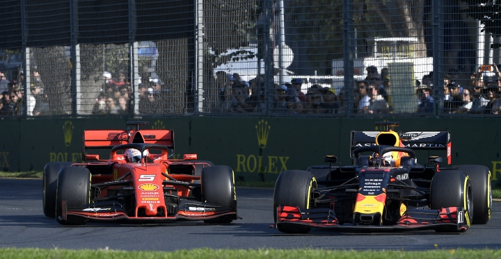 Red Bull driver Max Verstappen of the Netherlands, right, passes Ferrari driver Sebastian Vettel of Germany during the Australian Formula 1 Grand Prix in Melbourne, Australia, Sunday, March 17, 2019. (AP Photo/Andy Brownbill)