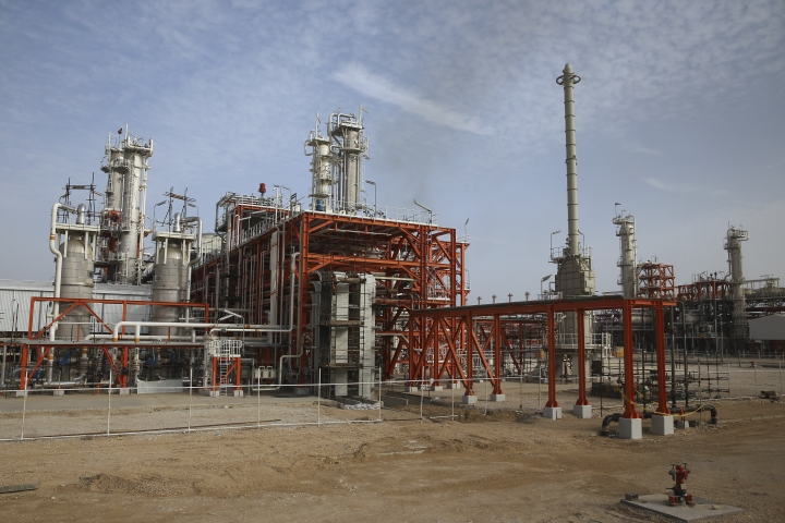 This Saturday, March 16, 2019 photo, shows a natural gas refinery at the South Pars gas field on the northern coast of the Persian Gulf, in Asaluyeh, Iran. Iran's President Hassan Rouhani on Sunday inaugurated a new phase in the development of the South Pars natural gas field. Iran says the development will allow Iran to overtake Qatar in the production of natural gas. The two countries are among the biggest gas producers in the world, and share the South Pars gas field. (AP Photo/Vahid Salemi)