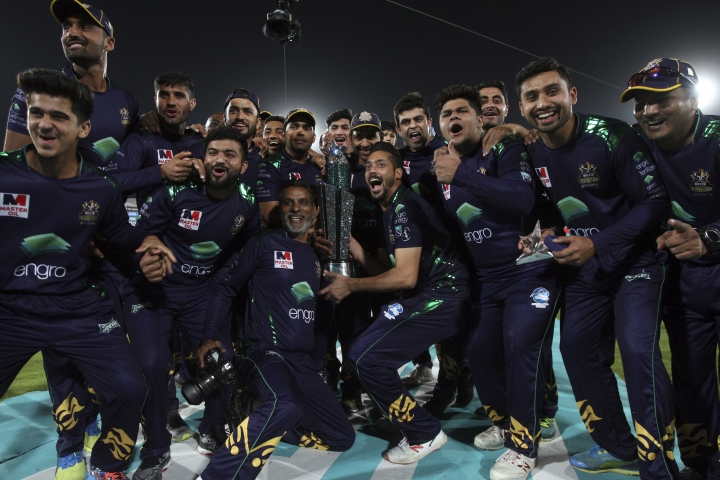 Players and officials of Quetta Gladiator pose for photograph with trophy after won the final cricket match of Pakistan Super League against Peshawar Zalmi at National stadium in Karachi, Pakistan, Sunday, March 17, 2019. (AP Photo/Fareed Khan)