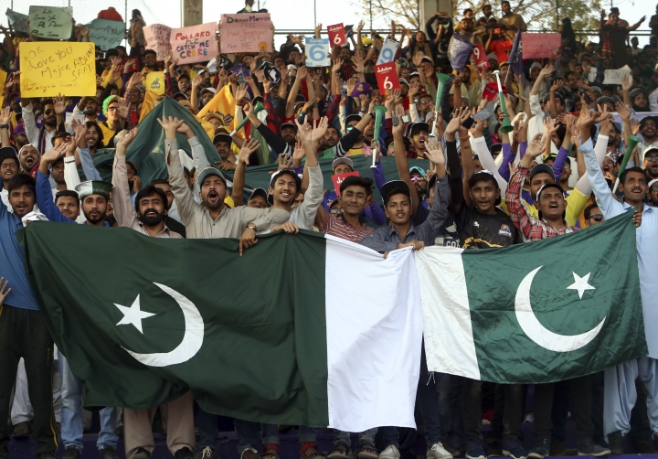 Cricket fans cheer before the start final cricket match of Pakistan Super League at National stadium in Karachi, Pakistan, Sunday, March 17, 2019. (AP Photo/Fareed Khan)