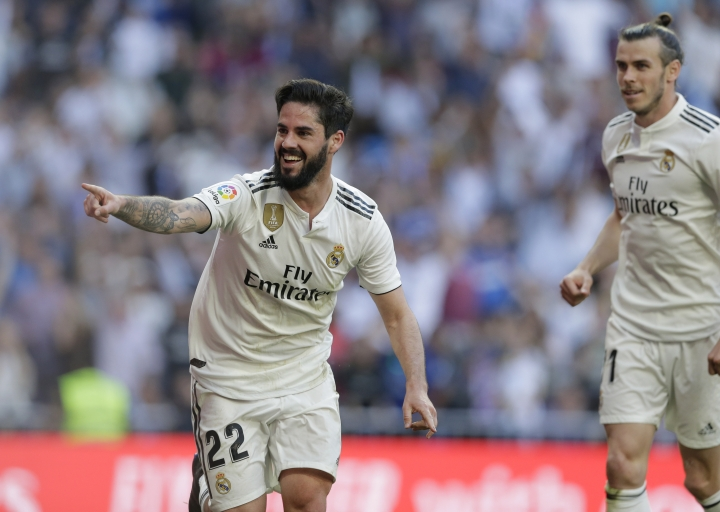 Real Madrid's Isco celebrates after scoring during a Spanish La Liga soccer match between Real Madrid and Celta at the Santiago Bernabeu stadium in Madrid, Spain, Saturday, March 16, 2019. At right his Real Madrid's Gareth Bale. (AP Photo/Paul White)