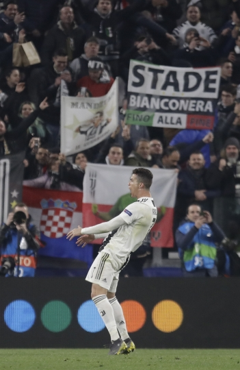 Juventus' Cristiano Ronaldo reacts at the end of the Champions League round of 16, 2nd leg, soccer match between Juventus and Atletico Madrid at the Allianz stadium in Turin, Italy, Tuesday, March 12, 2019. (AP Photo/Luca Bruno)