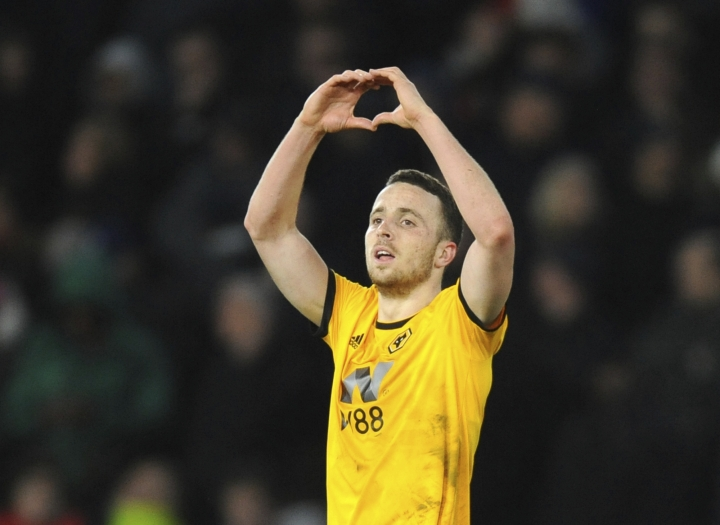 Wolverhampton's Diogo Jota celebrates after scoring his side's second goal during the English FA Cup Quarter Final soccer match between Wolverhampton Wanderers and Manchester United at the Molineux Stadium in Wolverhampton, England, Saturday, March 16, 2019. (AP Photo/Rui Vieira)