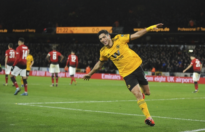 Wolverhampton's Raul Jimenez celebrates after scoring his side's opening goal during the English FA Cup Quarter Final soccer match between Wolverhampton Wanderers and Manchester United at the Molineux Stadium in Wolverhampton, England, Saturday, March 16, 2019. (AP Photo/Rui Vieira)