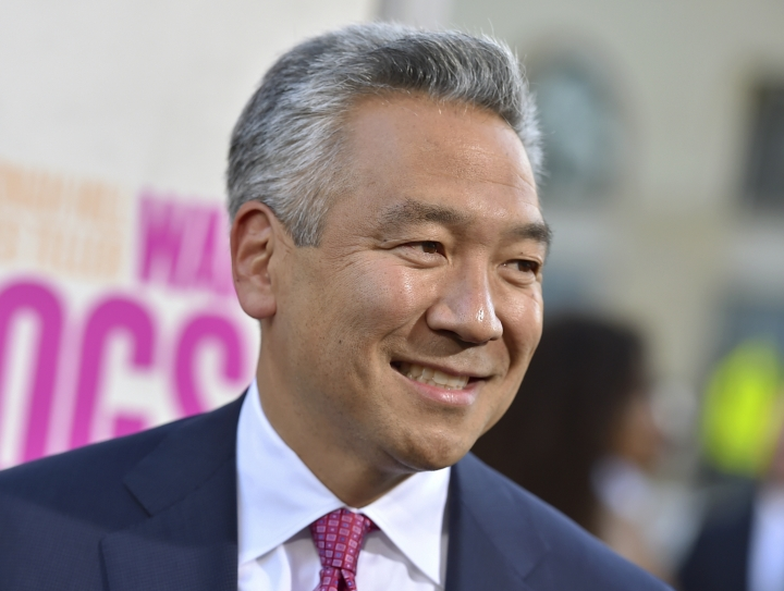 """FILE - In this Aug. 15, 2016 file photo, Kevin Tsujihara, chairman and CEO, Warner Bros. Entertainment, arrives at the Los Angeles premiere of """"War Dogs."""" Tsujihara is stepping down after claims that he promised acting roles in exchange for sex. As Warner Bros. chairman and chief executive officer at one of Hollywood's most powerful and prestigious studios, Tsujihara is one of the highest ranking executives to be felled by sexual misconduct allegations. (Photo by Jordan Strauss/Invision/AP, File)"""